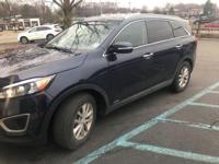 This outstanding example of a 2016 Kia Sorento LX is