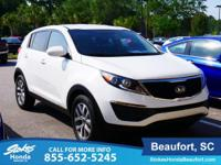 2016 Kia Sportage in White. A total gas saver. Fuel