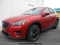 Look at this 2016 Mazda CX-5 Grand Touring. Its