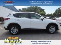 This 2016 Mazda CX-5 Sport in Crystal White Pearl Mica