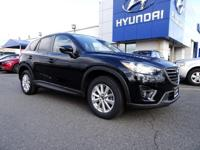 This 2016 Mazda CX-5 Touring is proudly offered by