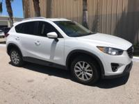 This 2016 Mazda CX-5 FWD 4dr Auto Touring is proudly