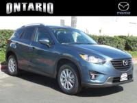 Boasts 33 Highway MPG and 26 City MPG! This Mazda CX-5