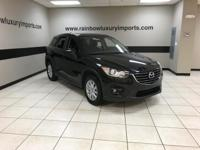 CARFAX 1-Owner. CX-5 Touring trim. EPA 33 MPG Hwy/26