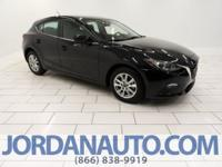 This Mazda3 has under 12,000 miles on it and is a