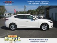 This 2016 Mazda Mazda3 i in White is well equipped