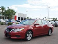 This 2016 Nissan Altima is a real winner with features