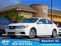 2016 Nissan Altima in White. CVT with Xtronic. Rare