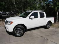 This 2016 Nissan Frontier 4dr 4WD Crew Cab SWB