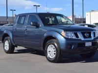 This 2016 Nissan Frontier comes with Gray cloth