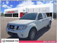 This 2016 Nissan Frontier SL has an exterior color of