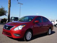 This 2016 Nissan Versa is complete with top-features