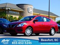 2016 Nissan Versa in Red. Traction control keeps you as