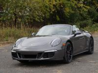 This is a Porsche 911 for sale by Manhattan Motorcars.