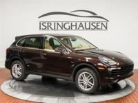 This beautiful 2016 Porsche Cayenne Diesel in Mahogany