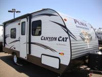 This PUMA Canyon Cat by Palomino RV is loaded with