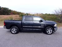 A very low mileage Big Horn Ram 1500 Crew Cab 4X4.
