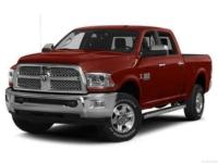 This 2016 Ram 2500 Laramie 4WD offered at Spike Dykes