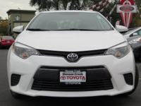 Options:  2016 Toyota Corolla Le Sedan|White/|V4 1.8 L