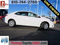 2016 Toyota Corolla LE in Super White includes, One