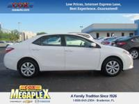 This 2016 Toyota Corolla S in White is well equipped