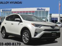 Clean CARFAX. White 2016 Toyota RAV4 Hybrid Limited AWD