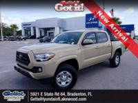 This 2016 Toyota Tacoma SR5 in Quicksand features: