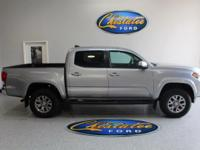 From mountains to mud, this Gray 2016 Toyota Tacoma TRD