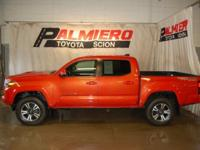 This 2016 Toyota Tacoma Sport in Inferno Red features: