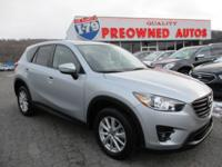 This 2016 Mazda CX-5 Touring is proudly offered by Joe