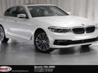 This 2017 BMW 540i Mineral White Metallic exterior, and