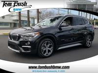 This outstanding example of a 2017 BMW X1 xDrive28i is