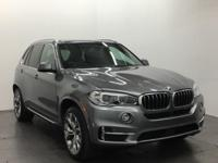Moonroof, Heated Seats, Third Row Seat, Nav System,