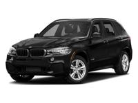 BMW X5 xDrive35i equipped with Navigation, Rear-view