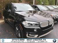 This BMW X5 boasts a Intercooled Turbo Gas/Electric I-4