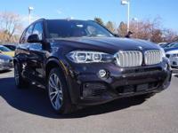 BMW INDIVIDUAL RUBY BLACK OVER AMORA BROWN MERINO