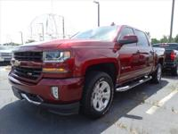 This Burgundy 2017 Chevrolet Silverado 1500 LT might be