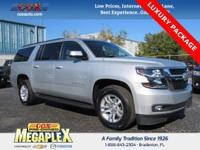 This 2017 Chevrolet Suburban LT in Champagne Silver