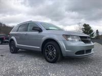 This outstanding example of a 2017 Dodge Journey SE is