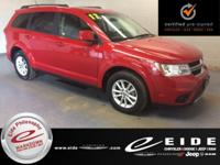 This 2017 Dodge Journey SXT is Redline exterior with