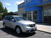 Journey SXT and AWD. A select one-owner vehicle. Lots