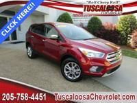 This 2017 Ford Escape SE in Ruby Red Metallic Tinted