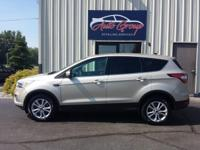 Our 2017 Ford Escape SE 4WD is a knockout in White Gold