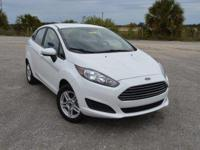 This low mileage, one owner Ford Fiesta SE Sedan comes