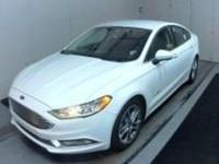 This 2017 Ford Fusion Hybrid SE is offered to you for