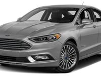 This 2017 Ford Fusion 4dr Hybrid Titanium FWD features