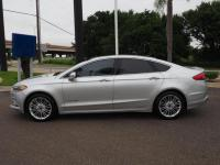 This 2017 Ford Fusion Hybrid Titanium features a backup