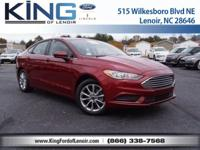 This 2017 Ford Fusion SE features a push button start,