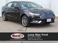 This Ford won't be on the lot long! Clean, sporty and