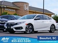 2017 Honda Civic in White. Traction control keeps you